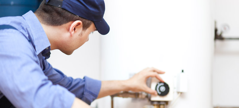 Tod has just finished a water heater repair in Leesburg VA and makes final adjustements